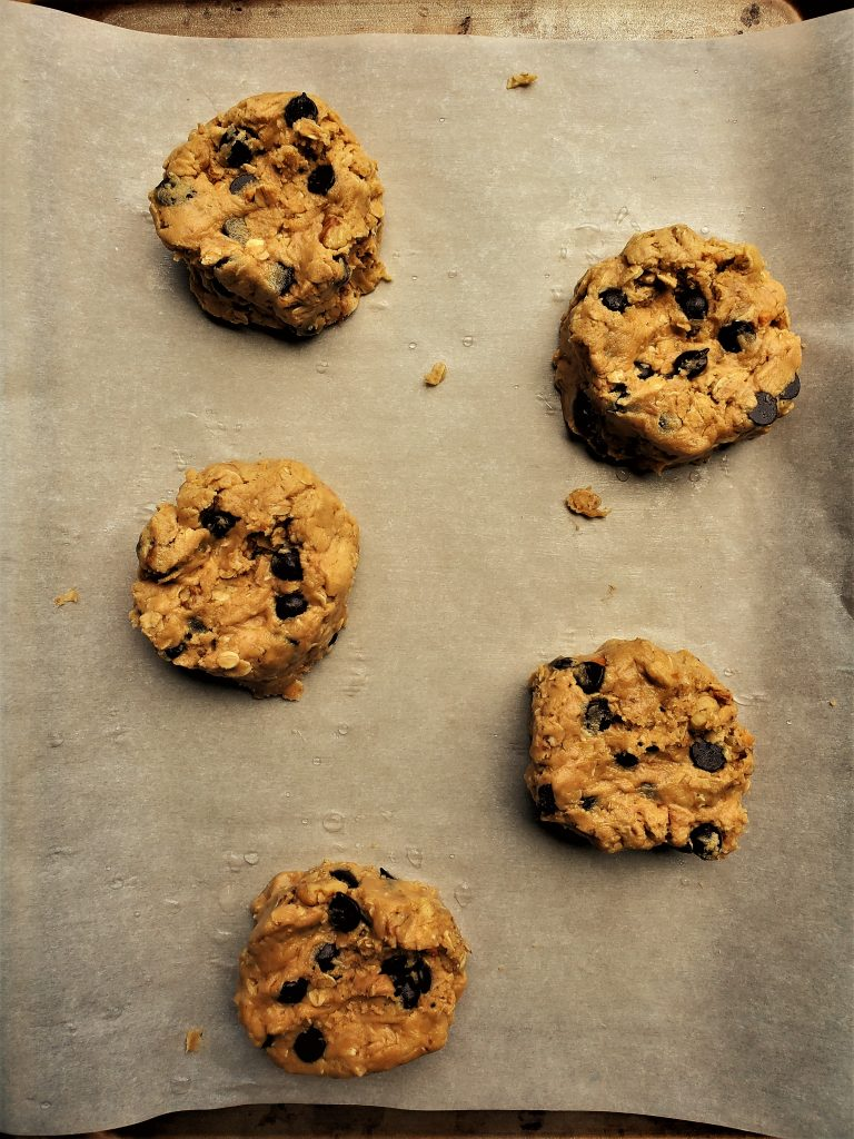 Peanut Butter Chocolate chip oatmeal cookie dough on a cookie tray